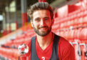 Graeme Shinnie with the Evening Express Aberdeen FC Player of the Year trophy