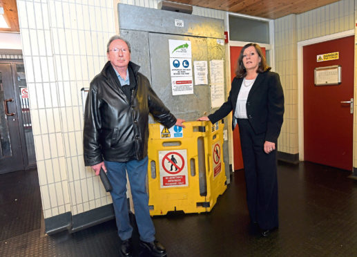 Roger Carlund and Councillor Jennifer Stewart at Wallace House, Provost Graham Avenue, Hazlehead, where residents have been told they must pay £6,000 upfront for the lifts to be refurbished.