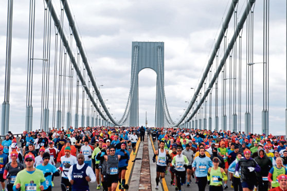 Runners cross the Verrazano-Narrows Bridge at the start of the New York City Marathon.
