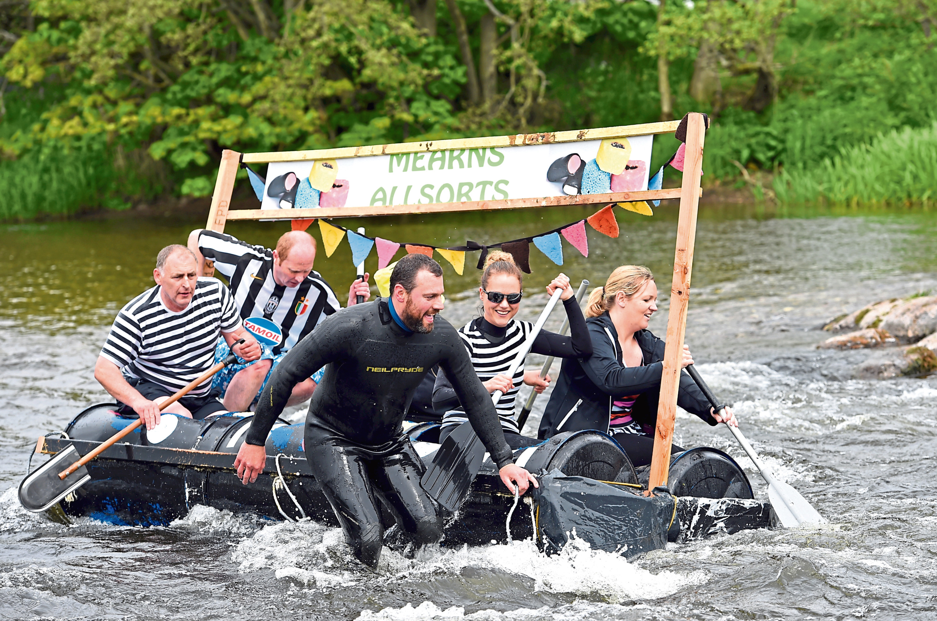The annual raft race on the North Esk river.