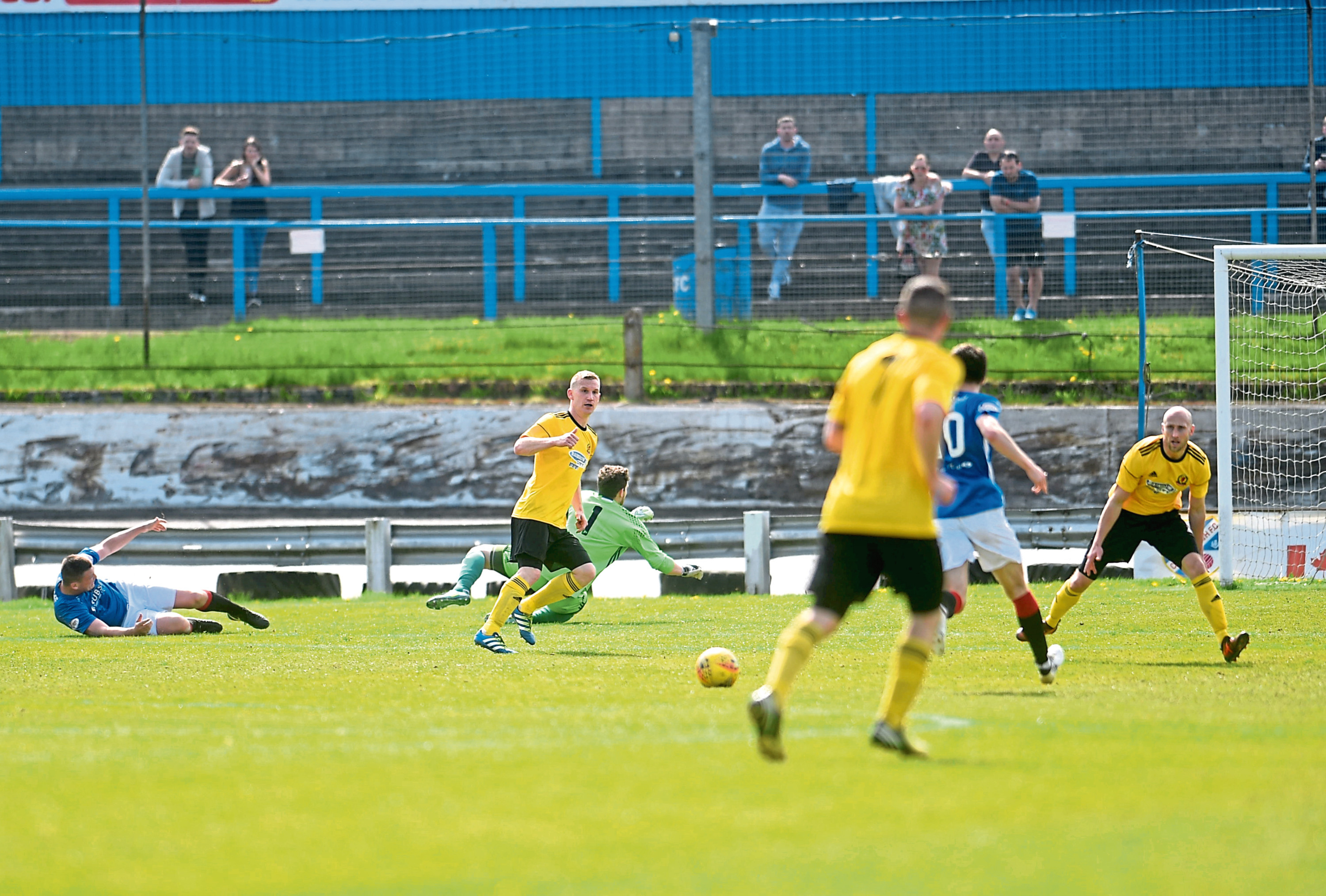 Stuart McKenzie being floored by Cowdenbeath player Jordyn Sheerin in the lead-up to the home side's winner