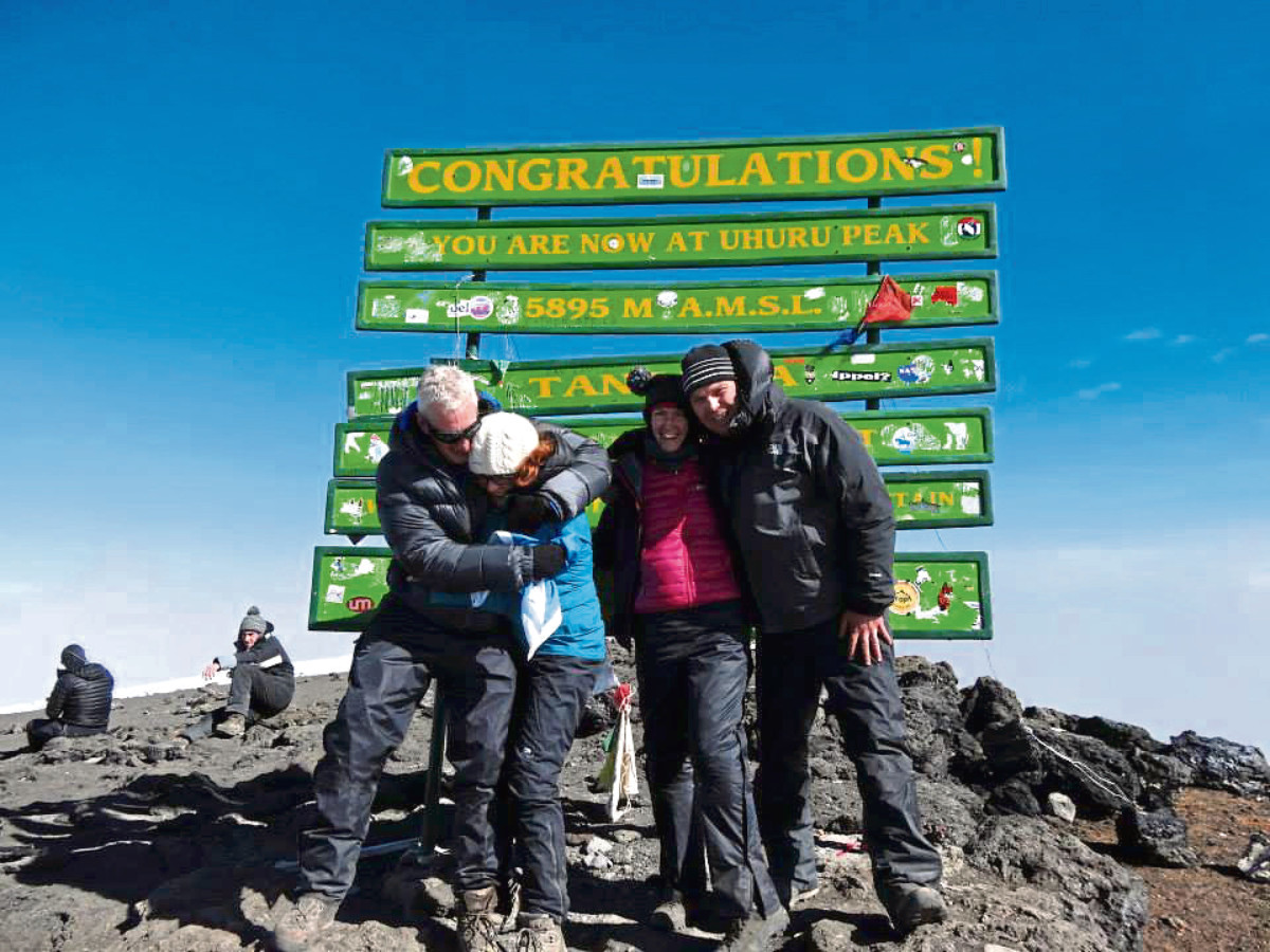 Anne Smith at the top of Mount Kilimanjaro – just one of the challenges she has undertaken to raise funds for cancer research