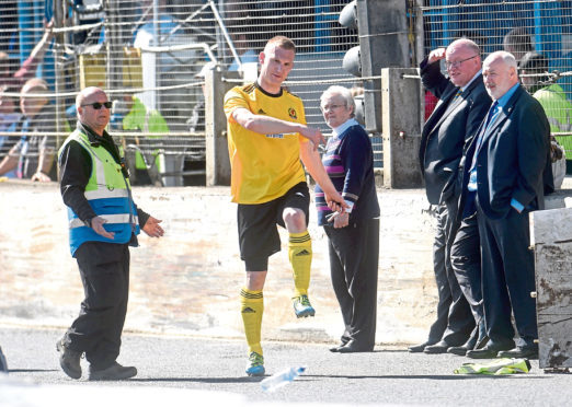 Cove captain Eric Watson kicking out after being sent off. Picture by Darrell Benns