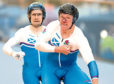 Neil Fachie, left, at the Commonwealth Games with Matt Rotherham.