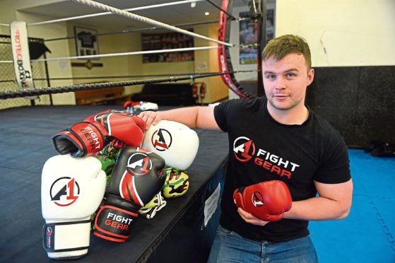 Sean Cowie is giving away 50 pairs boxing gloves to underprivileged children.