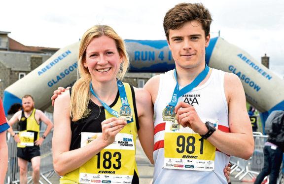 Ladies winner Fiona Brian with Mens winner Broc Drury.