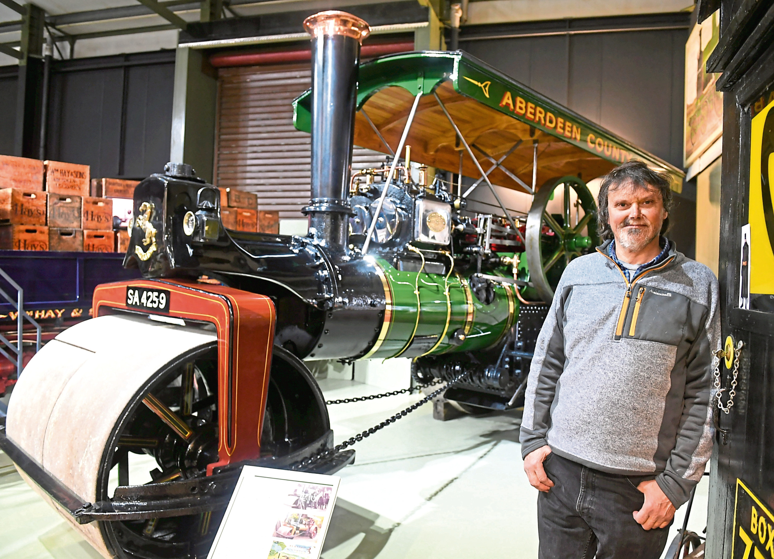 Mike Ward next to a 1920s steam road roller
