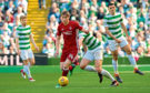 Dean Campbell skips away from Celtic's Kristoffer Ajer.