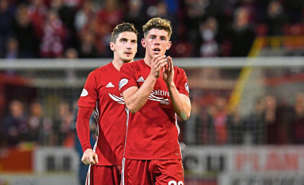 Ryan Christie and Kenny McLean applaud the fans at full-time.