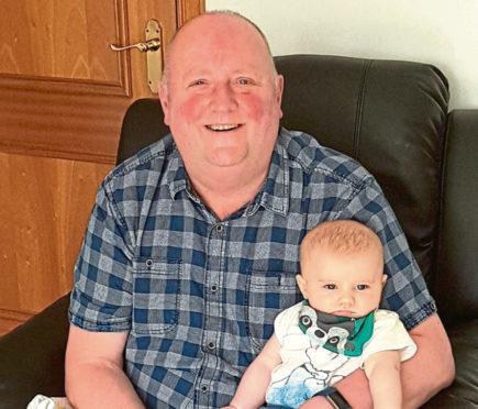 Douglas Stevenson with his grandson Vaughn