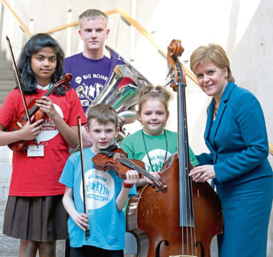 First Minister of Scotland Nicola Sturgeon with young musicians, from left,  Harine Uthayakumar, 11, Tommy Hill, 17, Logan Gerrard, 9, and Martyna Szwabowicz, 7