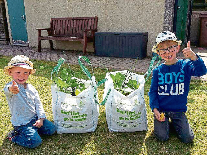 Callum, 3, and Rory, 5, McCafferty from Countesswells with their VegBags