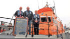 Keith Webb presents a Newvburgh-on-Ythan Lifeboat Station service board dated 1889 to Bill Deans, Aberdeen Lifeboat operations manager and Bec Allen, honorary secretary of RNLI's Aberdeen Branch.