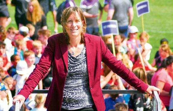Aberdeen Youth Games ambassador Dame Katherine Grainger with the children at Aberdeen Sports Village
