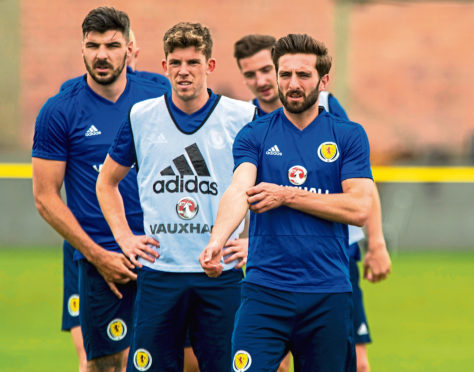 Graeme Shinnie, right, training with Scotland in Peru in the summer.