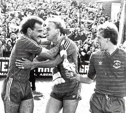 Willie Miller, Neale Cooper and Neil Simpson celebrate a goal against Celtic.