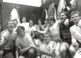 The team celebrates winning the League title against Hearts with a champagne shower, courtesy of Neale Cooper, in 1984