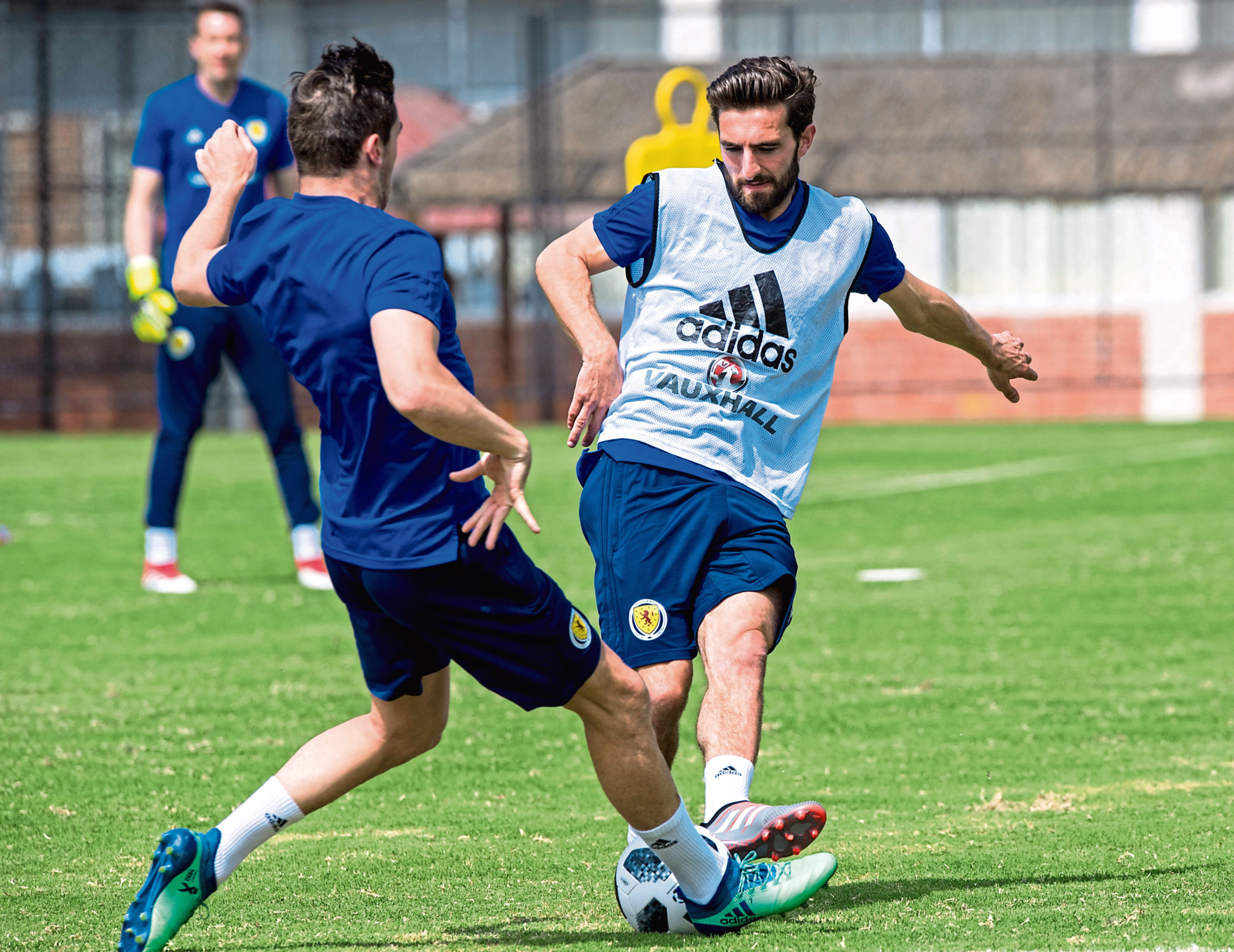 Graeme Shinnie (right) competes with Kenny McLean in training with Scotland.