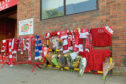 Tributes to Neale Cooper have been left at Pittodrie.