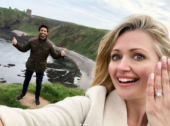 Hayley shows off her ring in front of Dunnottar Castle.