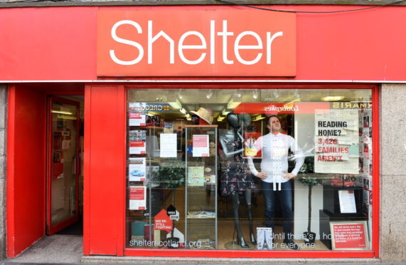 Reporter Lee McCann trying on designer clothes at Shelter on George Street, Aberdeen