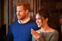 Prince Harry and Meghan Markle watch a performance by a Welsh choir in the banqueting hall during a visit to Cardiff Castle.
