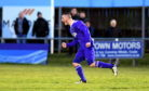 Cove's Ryan Stott celebrates his goal.
