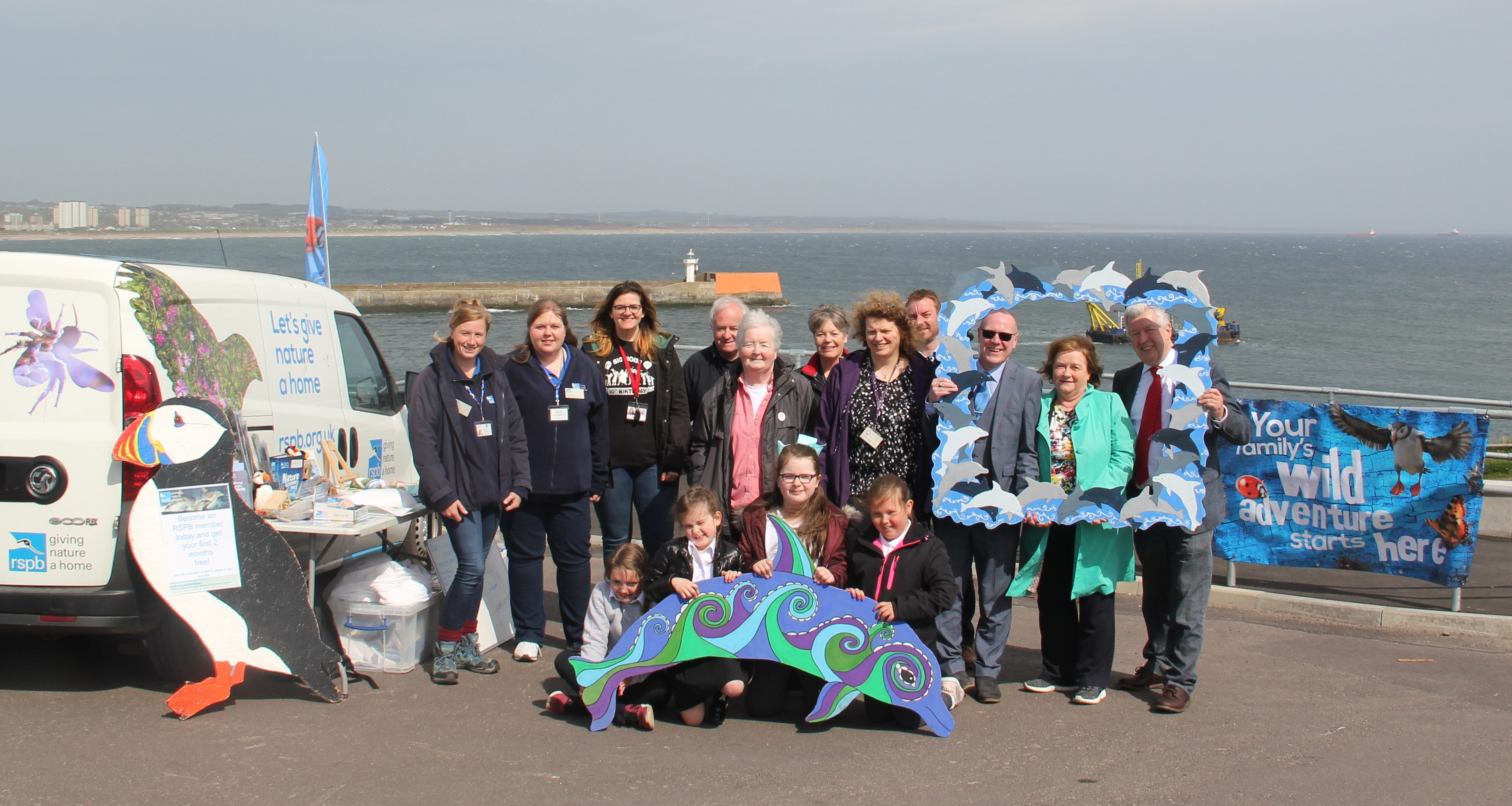 The team, supporters and children from Kirkhill Primary with dolphin 'Oceana' at launch of new Dolphinwatch programme.