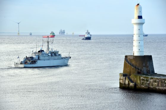 A NATO mine hunter leaves the city on its way to the Baltic.
