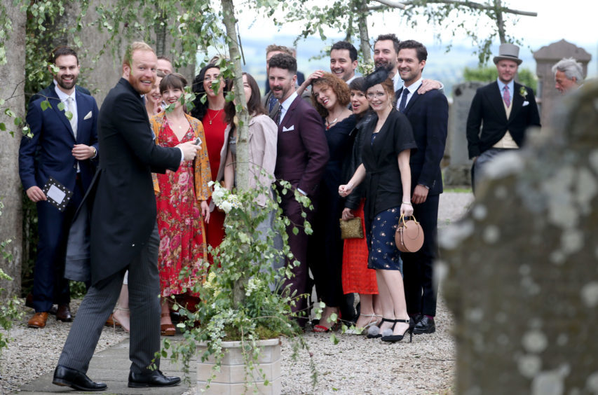 Guests pose for a group photograph, including Ben Aldridge (right) at Rayne Church