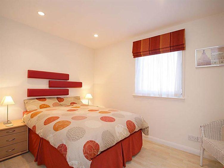 Master bedroom with walk-in wardrobe