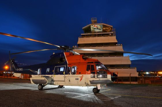 A helicopter outside Aberdeen's Air Traffic Control Tower.
