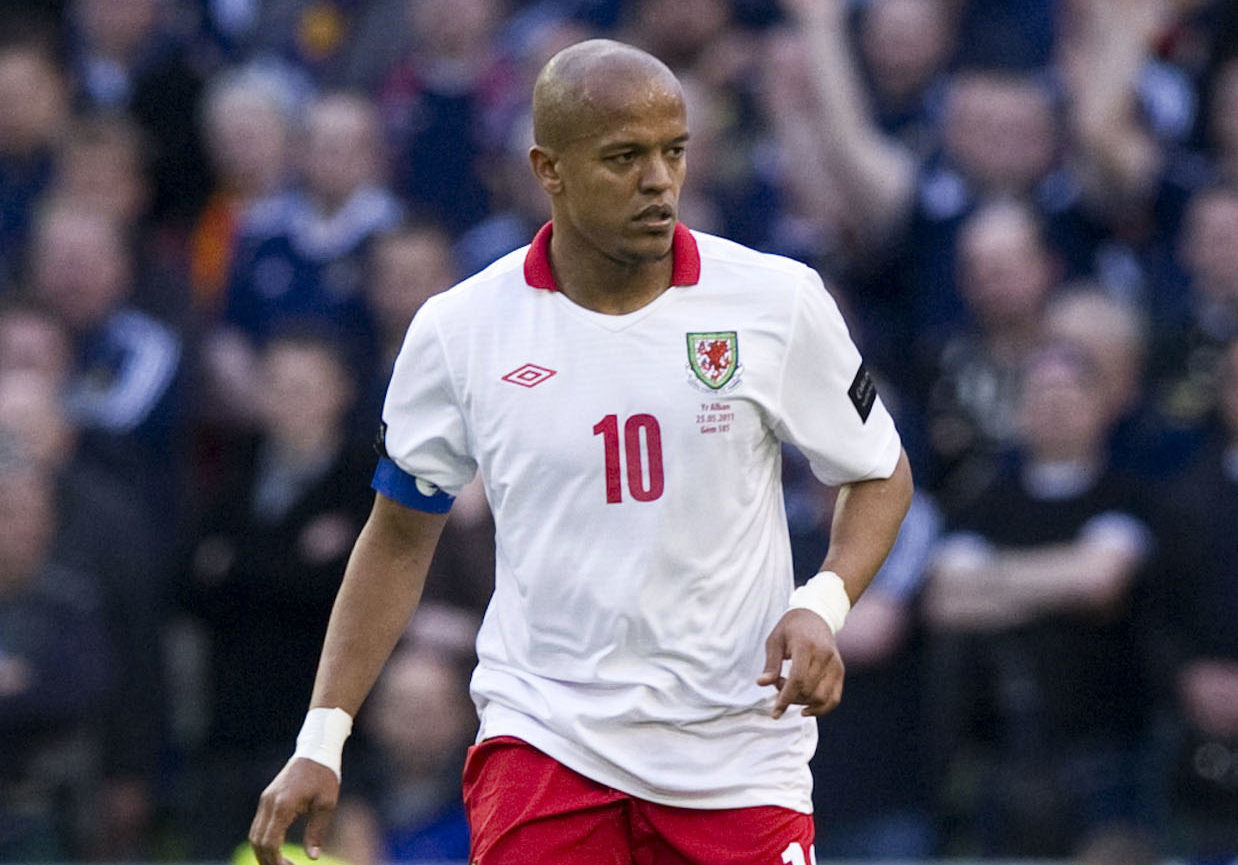 Robert Earnshaw in action for Wales in a 3-1 loss to Scotland in 2011. Both Earnshaw and Miller captained the sides