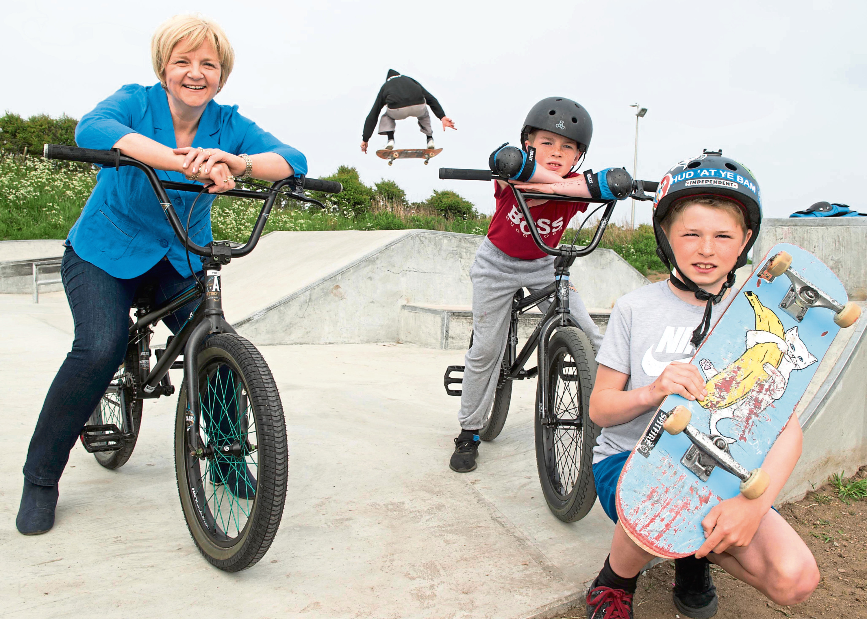 Councillor Jenny Laing opening the Torry Skatepark which board game designer Sean-Paul Gordon, pictured right, also designed in 2018