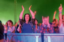Cast fans show their appreciation as the band perform on stage at the Enjoy Music event