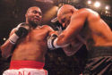 Danny Williams, left, delivers a blow to the head of Mike Tyson during their bout Friday, July 30, 2004, at Freedom Hall in Louisville,