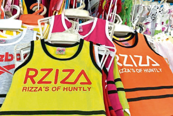 Rizzas of Huntly branded merchandise has appeared on stalls in Cambodia.