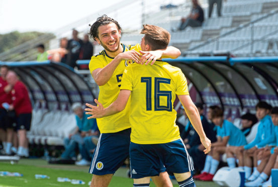 Scotland's Billy Gilmour (R) celebrates his goal with teammate Fraser Hornby.