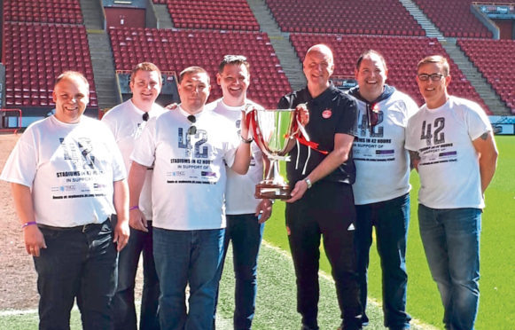The group picture with Neil Simpson and the replica trophy.