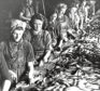 Hard at work gutting fish in an Aberdeen fish house in 1946.