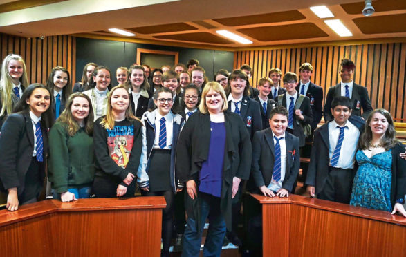 Hollyoaks actress Annie Wallace with senior pupils at Aberdeen Grammar School