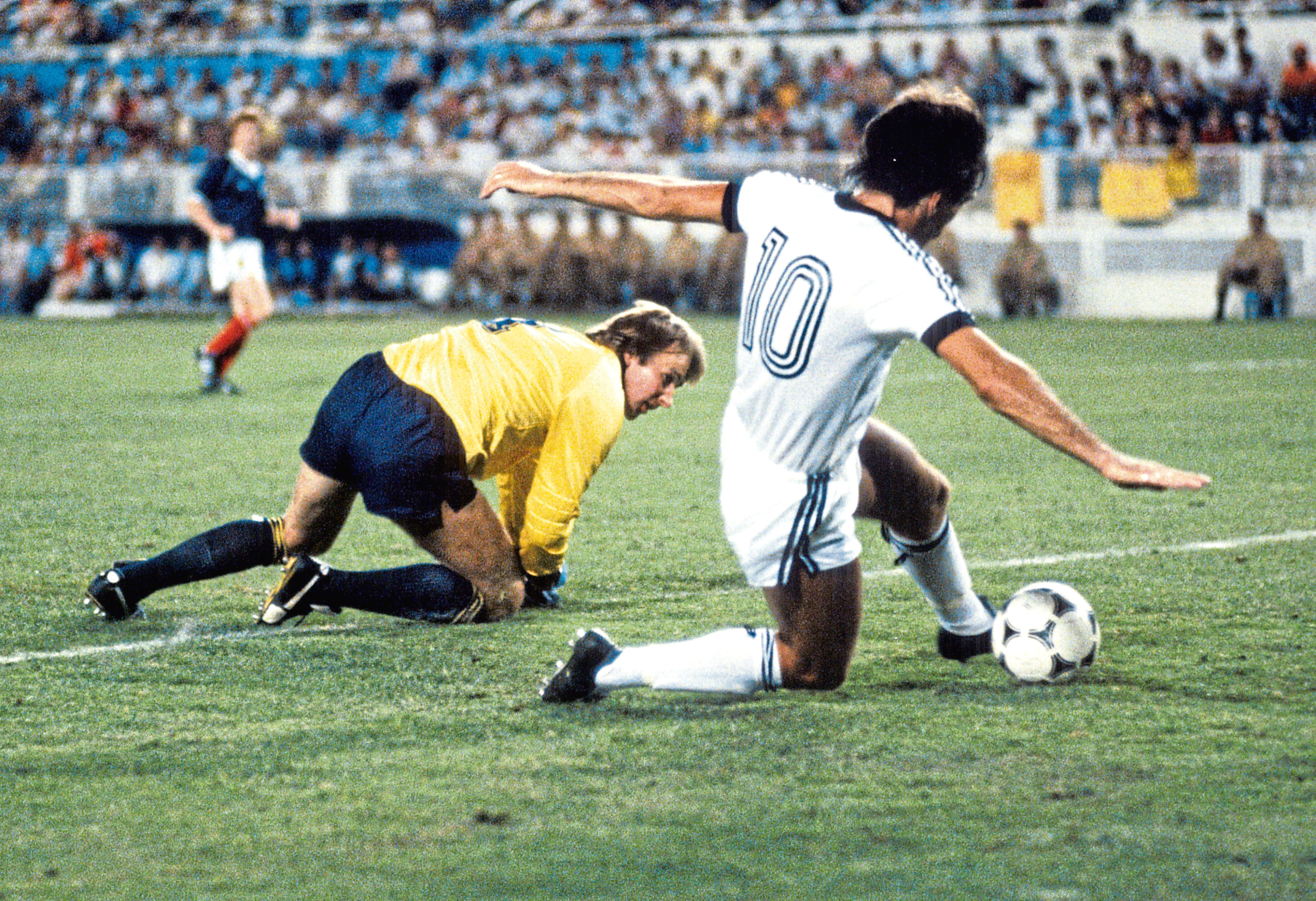 Scotland goalkeeper Alan Rough (left) looks on as New Zealand's Steve Sumner scoops the ball into the goal