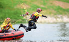 A firefighter jumps in the water and is rescued in simulation
