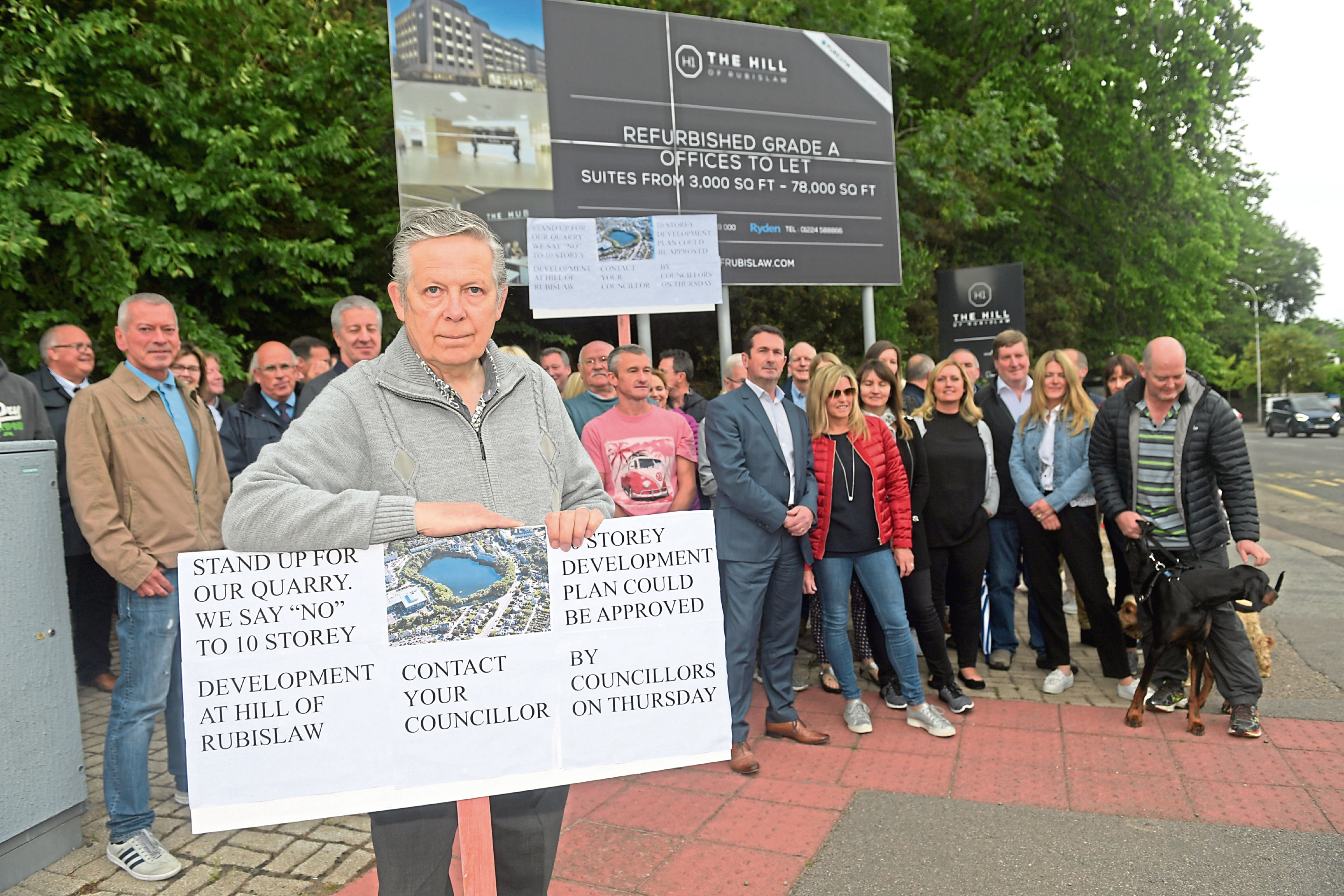 Secretary of Craigiebuckler and Seafield community council, William Sell. with protestors at Rubislaw Quarry.