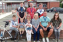 Jim's family gather after finishing the challenge