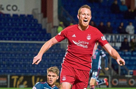 Adam Rooney celebrates a goal for Aberdeen