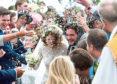 The newlyweds are showered with confetti after tying the knot