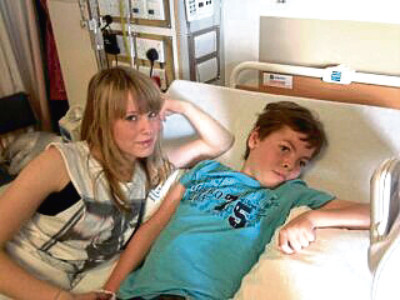 Jack, who requires round-the-clock care, with his sister Amy who is now 22.