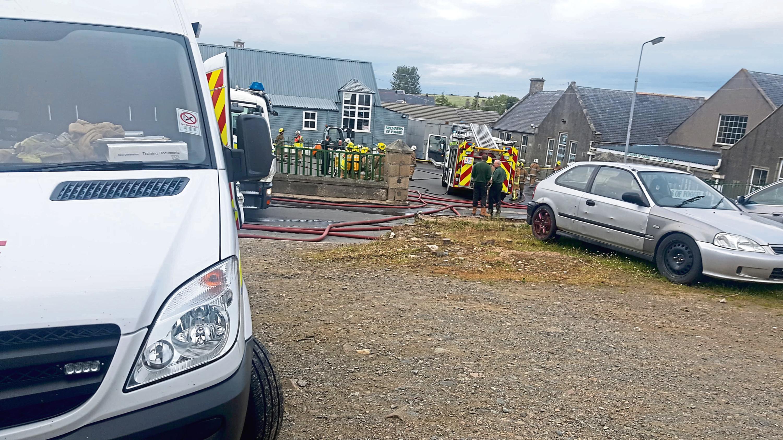 Emergency services outside the Aberchirder shop