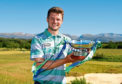 Winner of SSE Scottish Hydro Challenge David Law poses with the trophy.